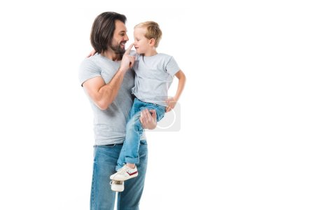 Awesome father hugging, holding and ceressing his son isolated on white