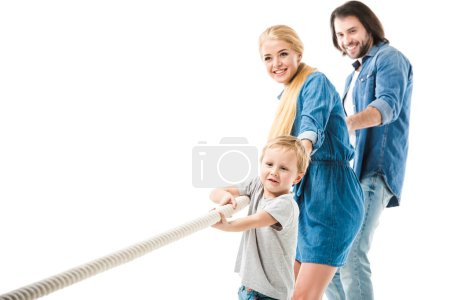 Photo for Happy family pulling the rope and playing tug of war isolated on white - Royalty Free Image