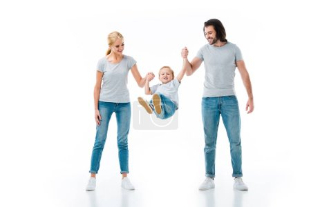 Parents throwing up their child while holding hands isolated on white