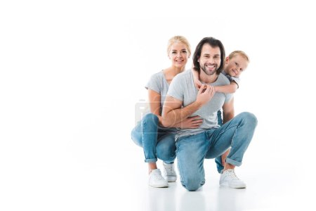 Smiling family hugging together isolated on white