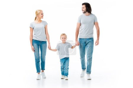Lovely family holding hands and looking at each other isolated on white