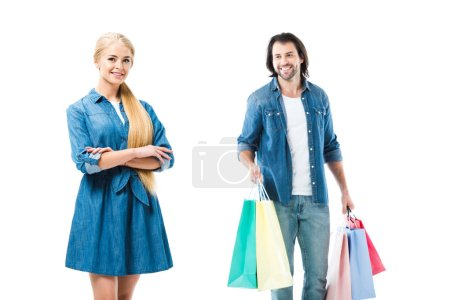 Lovely smiling couple in jeans with shopping bag isolated on white