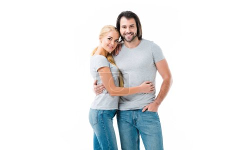 Lovely couple hugging and smiling at camera isolated on white