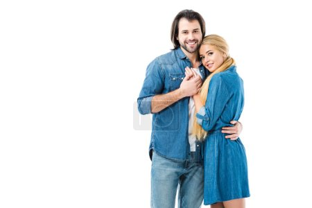 Lovely couple in jeans holding hands and hugging isolated on white