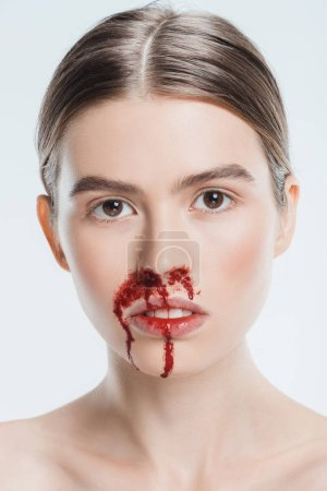 close up of woman with blood and injury on face isolated on white