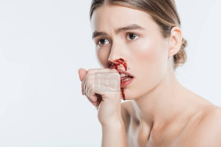 close up of female victim of domestic violence with blood on face isolated on white