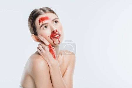 nude female domestic violence victim with red blood isolated on white