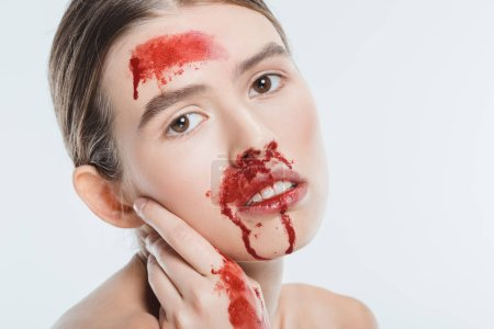 Photo for Close up of nude female domestic violence victim with red blood isolated on white - Royalty Free Image