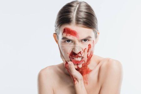 angry adult naked woman with blood on skin isolated on white, domestic violence concept
