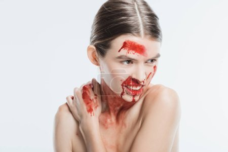aggressive adult naked woman with blood on skin isolated on white, domestic violence concept