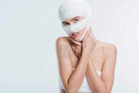 woman with bandages over head isolated on white