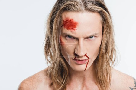 close up of angry man with bloody wounds on face isolated on white