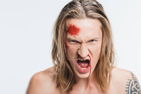 close up of angry shouting man with bloody wounds on face isolated on white