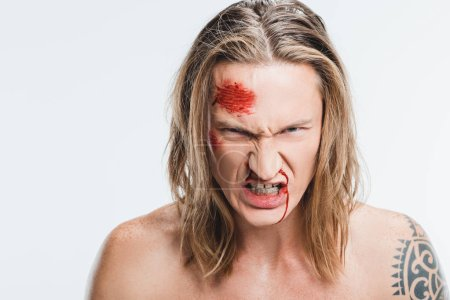 Photo for Close up of angry man with bloody wounds on face showing teeth isolated on white - Royalty Free Image