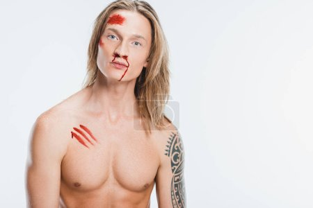 naked handsome man with bloody wounds on skin isolated on white