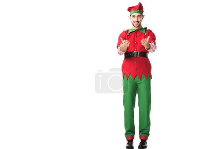 Photo for Smiling man in christmas elf costume with outstretched hands gesture isolated on white - Royalty Free Image