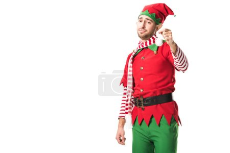 man in christmas elf costume holding bauble and looking at camera isolated on white background