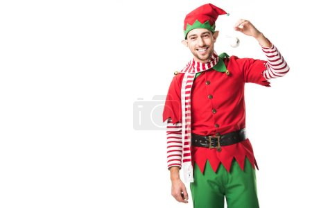 man in christmas elf costume holding bauble, smiling and looking at camera isolated on white
