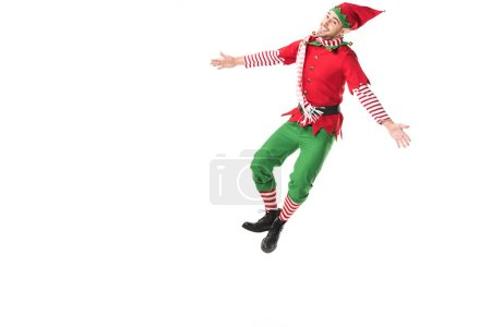 Photo pour Homme heureux en costume d'elfe de Noël sauter isolé sur fond blanc - image libre de droit
