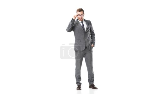 handsome adult businessman touching glasses isolated on white