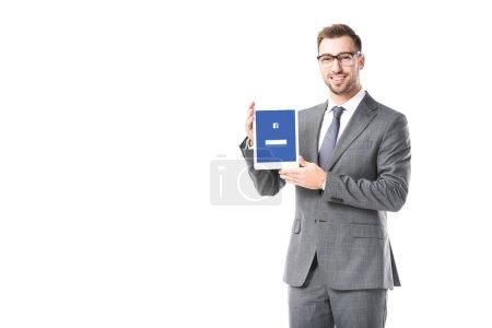 Photo pour Homme d'affaires adulte tenant une tablette numérique avec facebook app sur écran isolé sur blanc - image libre de droit