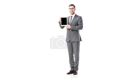 adult smiling businessman holding digital tablet with blank screen isolated on white
