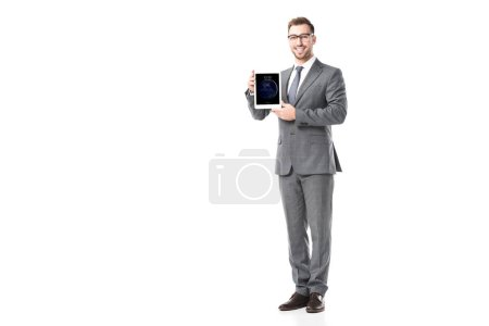 Photo for Adult smiling businessman holding ipad tablet isolated on white - Royalty Free Image