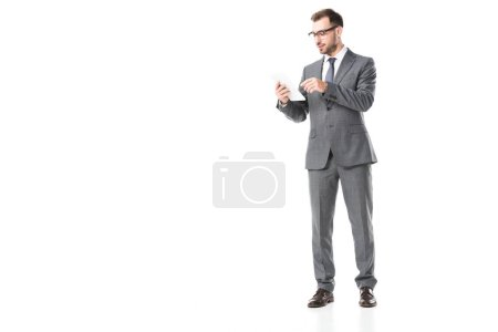 businessman in suit and glasses using digital tablet isolated on white