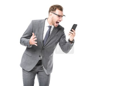 angry adult businessman shouting at smartphone isolated on white