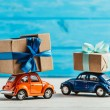 Close-up shot of toy cars with gift boxes on blue ...