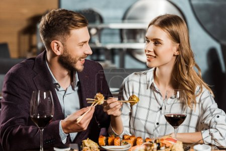 Attractive young adult couple having dinner in restaurant