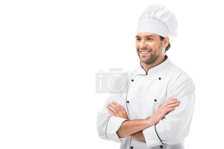 Foto de Guapo joven chef con los brazos cruzados mirando lejos, aislado en blanco - Imagen libre de derechos