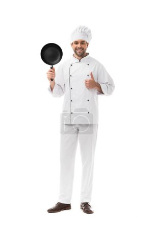 Photo for Happy young chef with frying pan showing thumb up isolated on white - Royalty Free Image