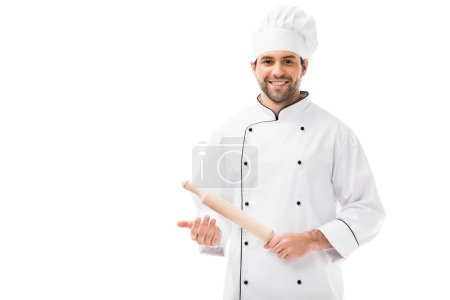 Photo for Smiling young chef holding rolling pin and looking at camera isolated on white - Royalty Free Image