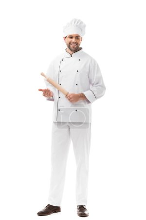 handsome young chef holding rolling pin isolated on white