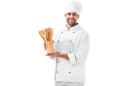 Photo for Happy young chef with bunch of wooden kitchen utensils isolated on white - Royalty Free Image