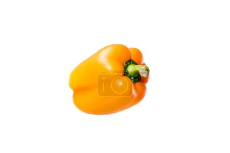 Close-up view of ripe orange bell pepper isolated on white