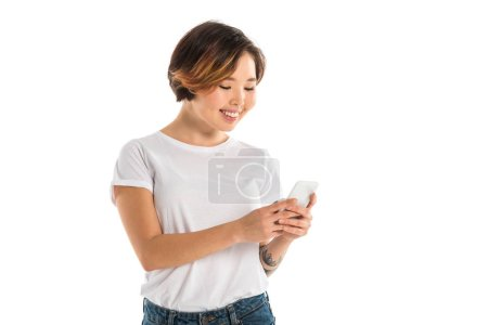 smiling young woman using smartphone isolated on white