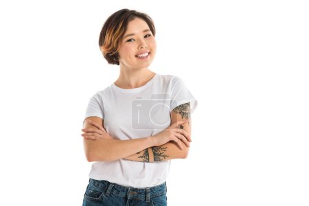 Photo for Young woman with arms crossed looking at camera and smiling isolated on white - Royalty Free Image