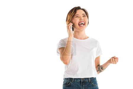 Photo for Laughing young woman talking on smartphone isolated on white - Royalty Free Image
