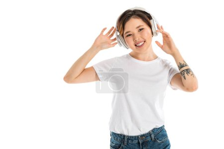 beautiful young woman wearing headphones and listening music isolated on white