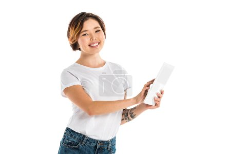 Photo for Beautiful smiling young woman using digital tablet isolated on white - Royalty Free Image
