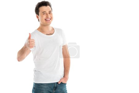 handsome smiling man showing thumbs up sign and looking at camera isolated on white