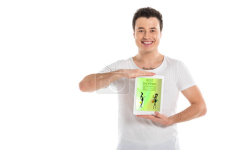 handsome man holding digital tablet with shopping app on screen isolated on white