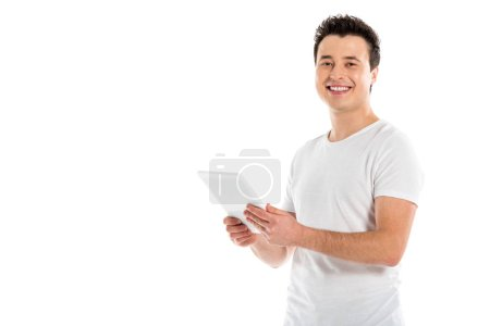 handsome man using digital tablet and looking at camera isolated on white