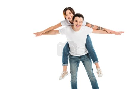 Photo for Happy husband giving wife piggyback ride isolated on white, couple having fun - Royalty Free Image