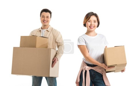 Photo for Happy couple looking at camera and holding cardboard boxes isolated on white, moving to new house concept - Royalty Free Image