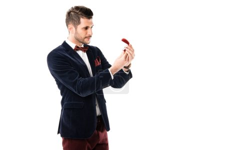 Photo for Attractive man holding ring box isolated on white - Royalty Free Image