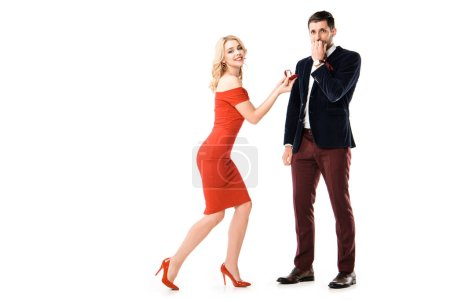 Beautiful blonde woman proposing boyfriend to marry isolated on white