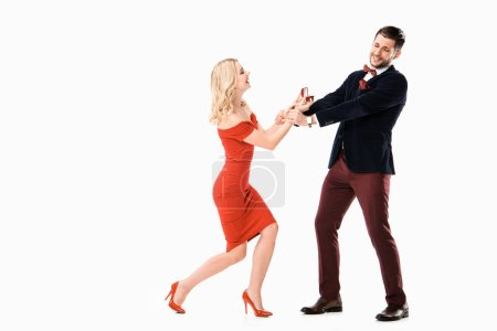 Attractive woman proposing boyfriend with ring isolated on white